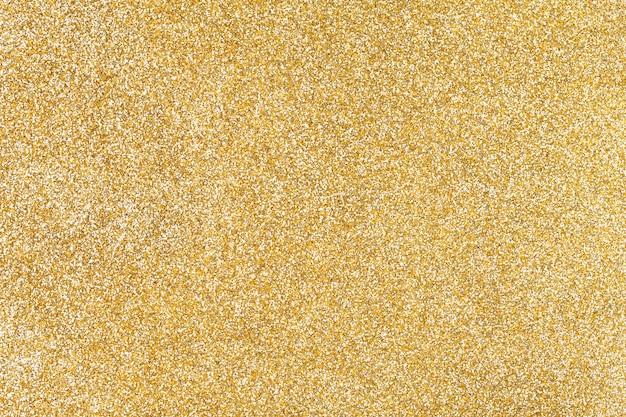 Fundo dourado brilhante de pequenas lantejoulas,