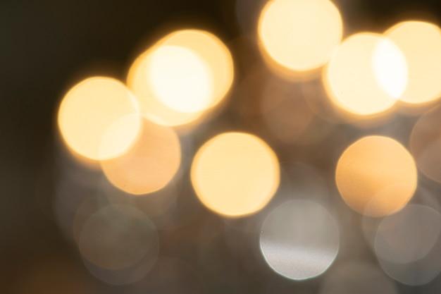Fundo dourado de luzes abstratas desfocados