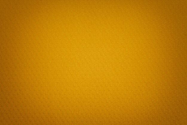Fundo dourado de um material têxtil com vime