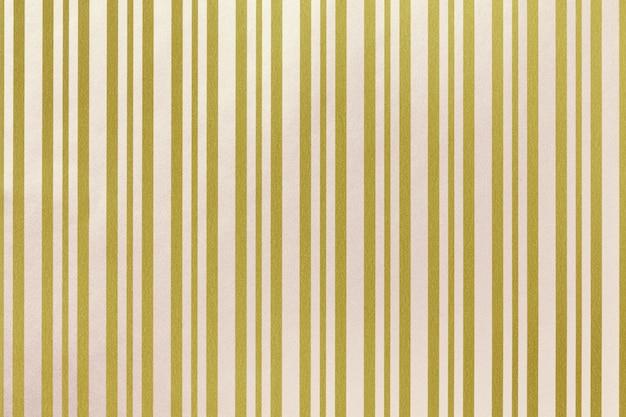 Fundo dourado e branco de embrulho de papel listrado.