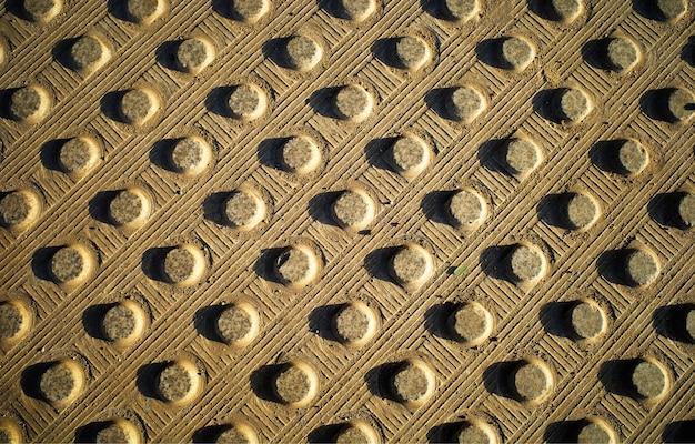 Fundo dramático da textura do asfalto da cidade com pontos de concreto