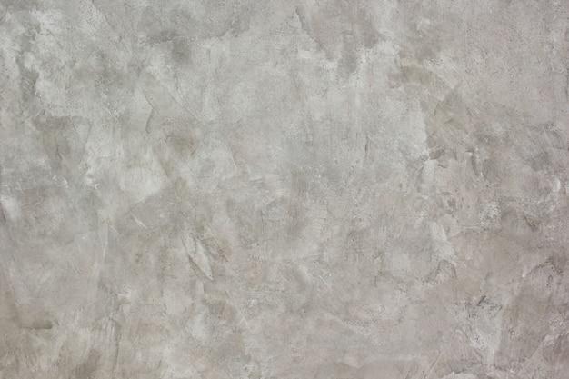 Fundo e superfície de reboco de cimento.