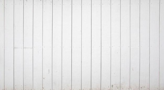 Fundo e textura de madeira brancos da cerca.
