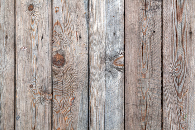 Fundo e textura de madeira velha decorativa listrada na parede de superfície