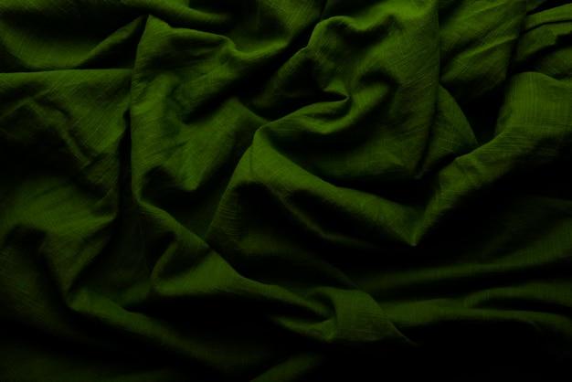 Fundo e textura de pano verde, com sulcos de abstrato de tecido verde