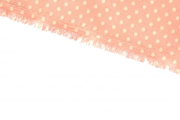 Fundo e textura de tecido de algodão empoeirado com bolinhas bege com franja ao longo da borda