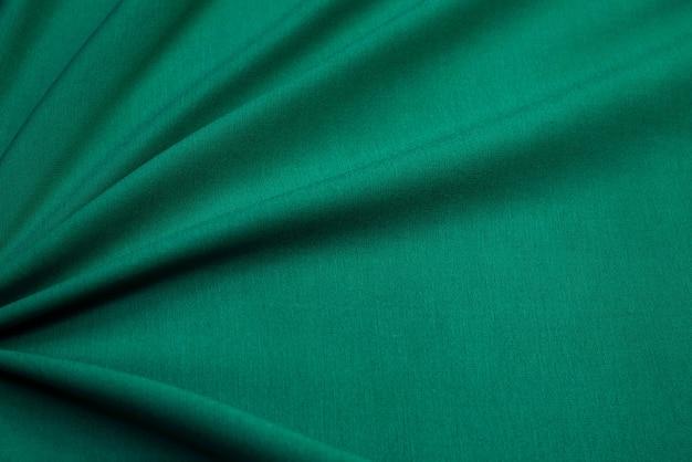 Fundo e textura de tecido de malhas verde