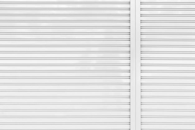 Fundo e textura do obturador da porta do rolo do metal