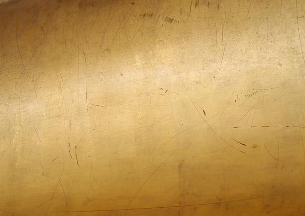 Fundo e textura do sumário da parede do ouro.