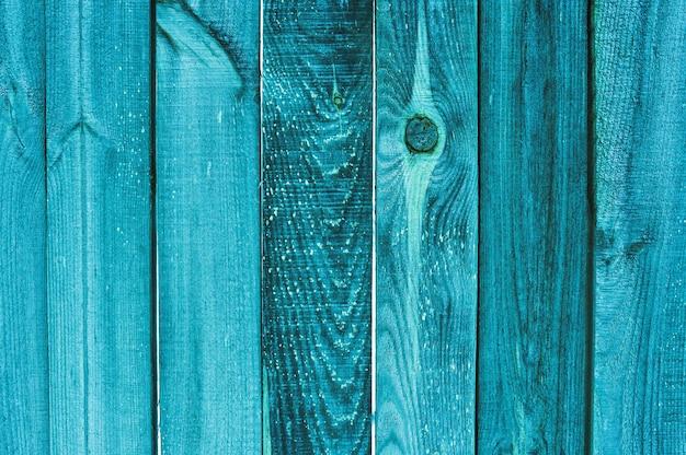 Fundo e textura velha cerca de madeira turquesa