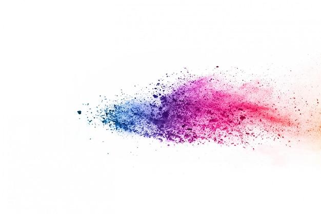 Fundo em pó abstrato splatted. explosão de pó colorido sobre fundo branco.