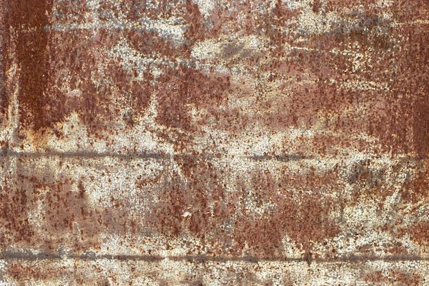 Fundo enferrujado de metal desgastado escuro. textura corroída