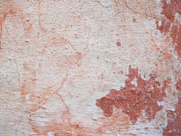 Fundo envelhecido e textura a parede do edifício antigo cimento e tinta velha
