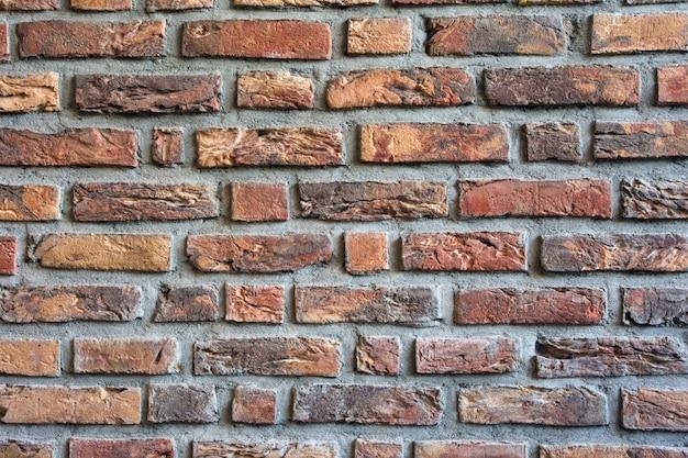 Fundo escuro de parede de tijolo