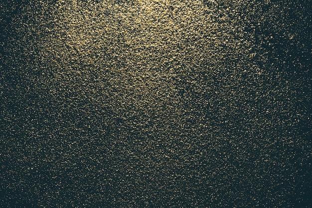 Fundo escuro de pó glitter dourado