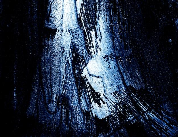 Fundo escuro e branco azul do sumário da textura do curso da escova.