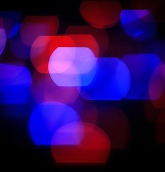 Fundo festivo com luzes coloridas desfocadas