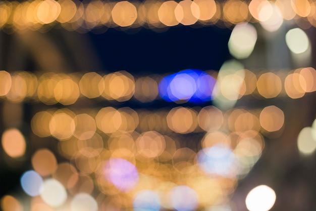 Fundo festivo com pontos de luz e no bokeh
