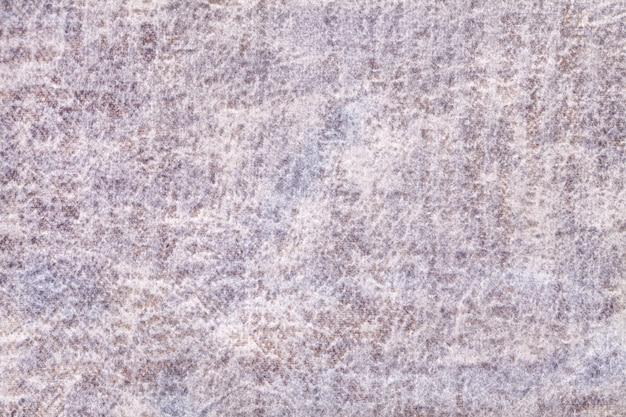 Fundo fofo cinza claro e pérola de tecido macio e felpudo. textura de tecido aveludado de marfim