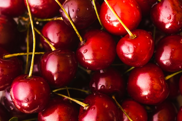 Fundo fresco de deliciosas cerejas