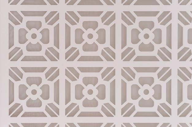 Fundo gráfico decorativo com flores. padrão de flores brancas em um fundo cinza. bege luxuoso abstrato. o padrão de pintura de textura pode ser usado para papel de parede ou azulejo da parede.
