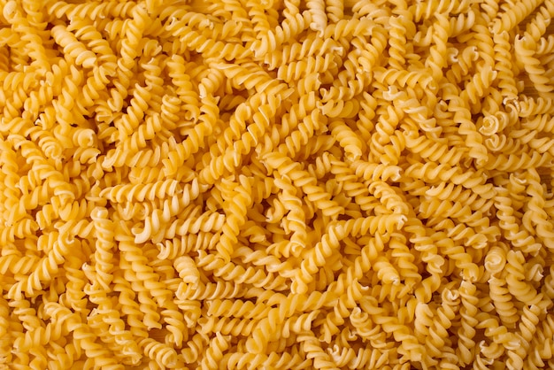 Fundo italiano dourado bonito da massa, alimento bio