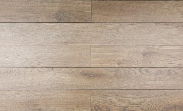 Fundo laminado. placas de madeira estratificadas e parquet para o piso em design de interiores. textura e padrão de madeira natural