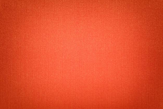 Fundo laranja brilhante de um material têxtil com vime,