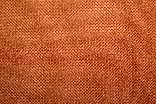 Fundo laranja da textura do tapete de ioga. fundo do tapete de acampamento