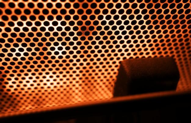 Fundo laranja padrão de grade pontilhada