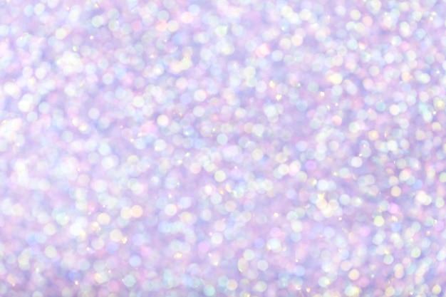 Fundo lilás brilhante borrado com luzes cintilantes.