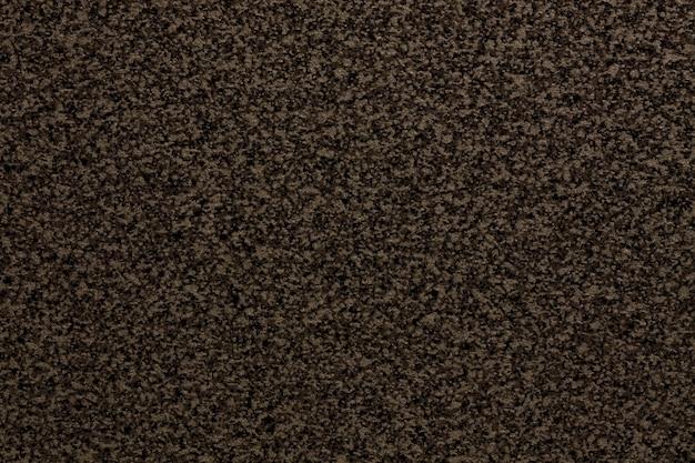 Fundo liso marrom escuro granulado com pequena textura de migalha.