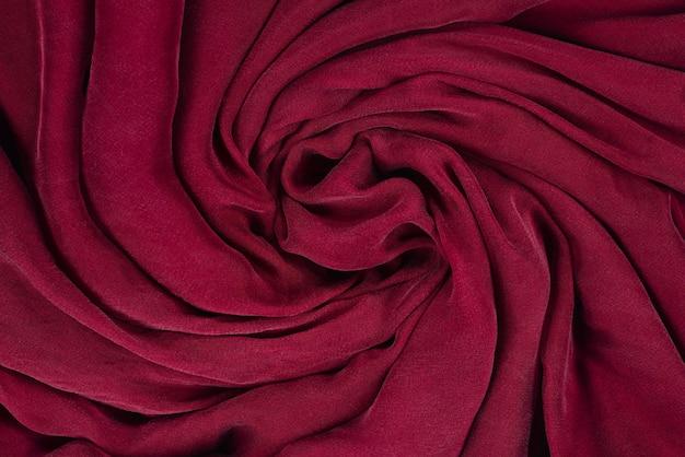 Fundo macio de tecido de seda cor de vinho. textura de tecido.