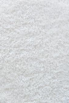 Fundo macio delicado branco de tecido de pelúcia
