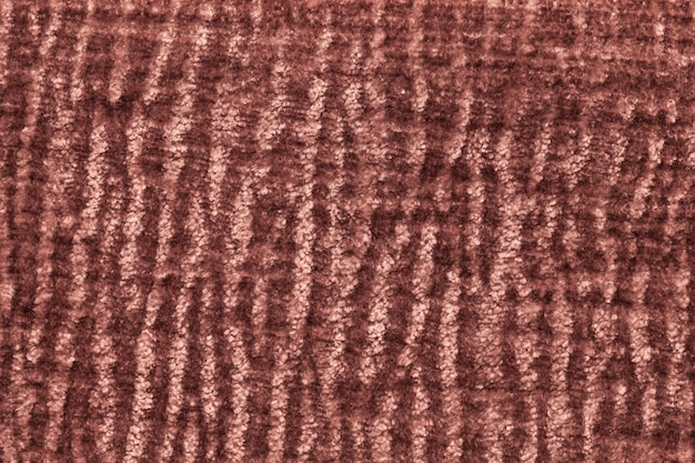 Fundo macio marrom escuro de pano macio e fofo. textura da matéria têxtil peludo do luxuoso, close up.