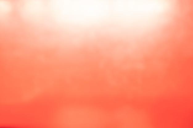 Fundo macio vermelho abstrato do papel de parede da cor pastel do inclinação claro da luz.