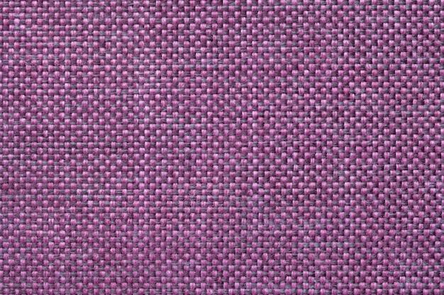 Fundo magenta de matéria têxtil, close up. estrutura da macro de malha.