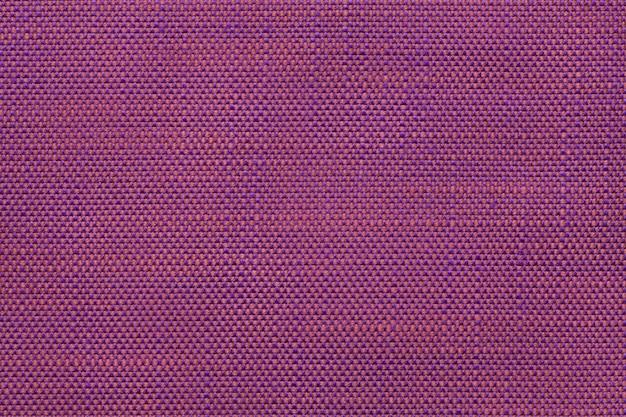 Fundo magenta de matéria têxtil com projeto quadriculado, close up.