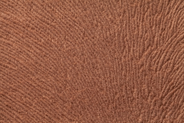 Fundo marrom claro de têxteis fleecy