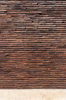 Fundo marrom da parede de tijolo do espaço da cópia