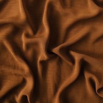 Fundo marrom de tecido de cetim amarrotado