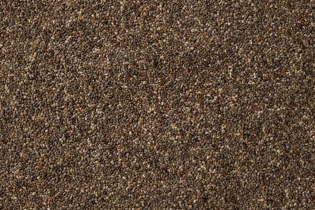 Fundo marrom do teste padrão das sementes de chia.