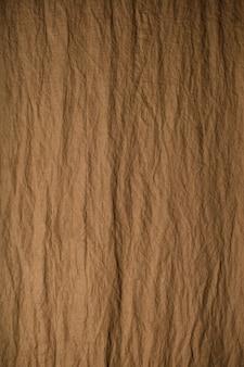 Fundo marrom para textura de estúdio fotográfico de tecido amassado
