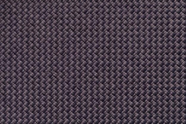 Fundo marrom têxtil com padrão xadrez.