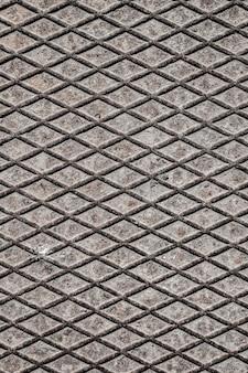 Fundo metálico com formas de diamante