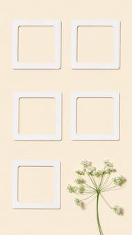 Fundo mínimo de outono com flores silvestres e papel rosa para anotações ou mensagens
