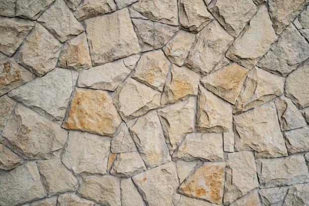 Fundo moderno da parede de tijolo de pedra. textura de pedra.
