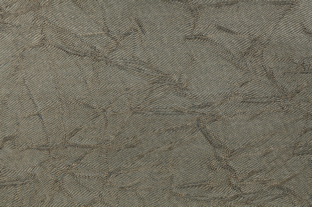 Fundo ondulado da verde azeitona de um material de matéria têxtil. tecido com textura natural closeup.