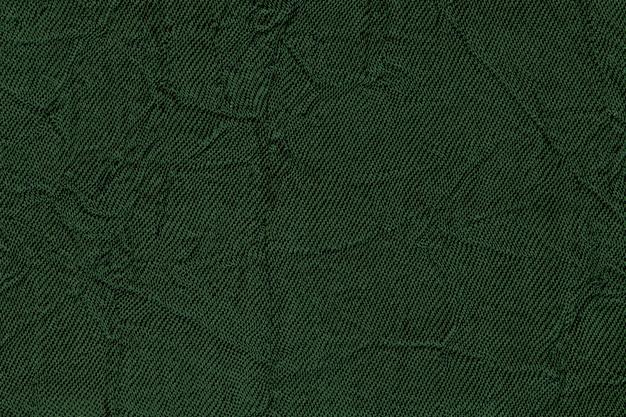 Fundo ondulado verde escuro de um material têxtil