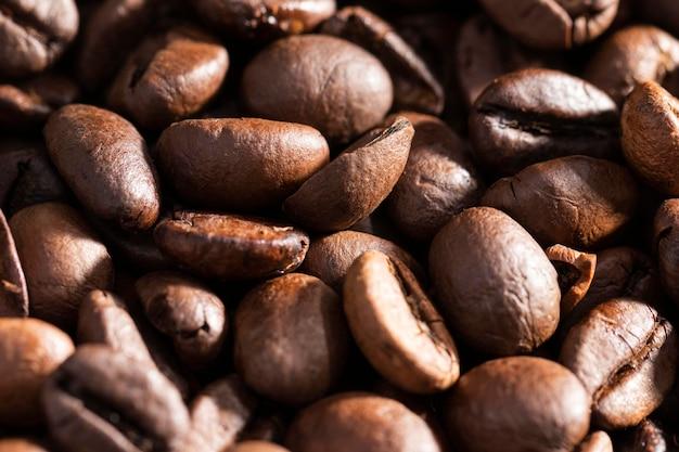 Fundo orgânico de grãos de café em close-up